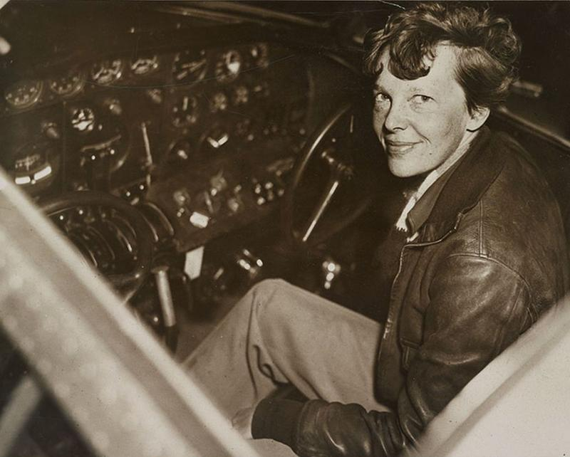 amelia-earhart-sitting-in-the-cockpit-of-an-electra-airplane